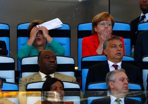 Dilma entre caras e bocas no momento em que foi vaiada no Maracanã.